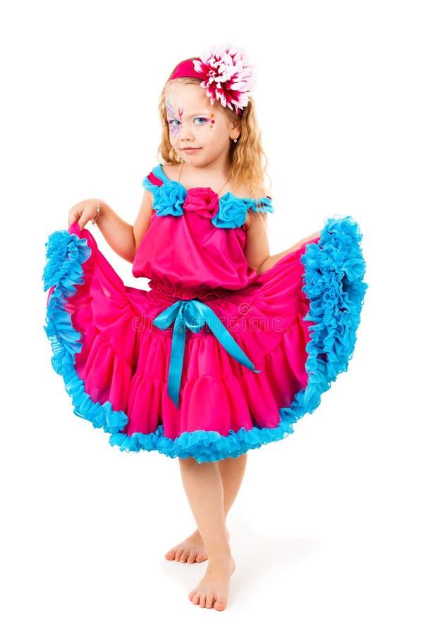 Menina bonita em um vestido vermelho imagens de stock