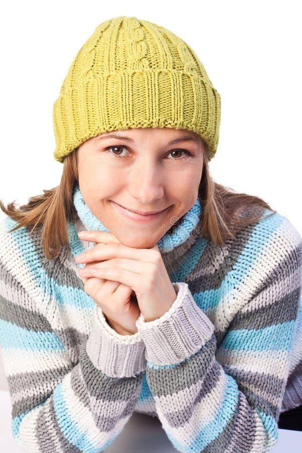 Menina bonita em uma camisola colorida fotos de stock