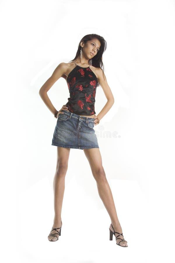 Menina bonita em uma saia da sarja de Nimes imagens de stock royalty free