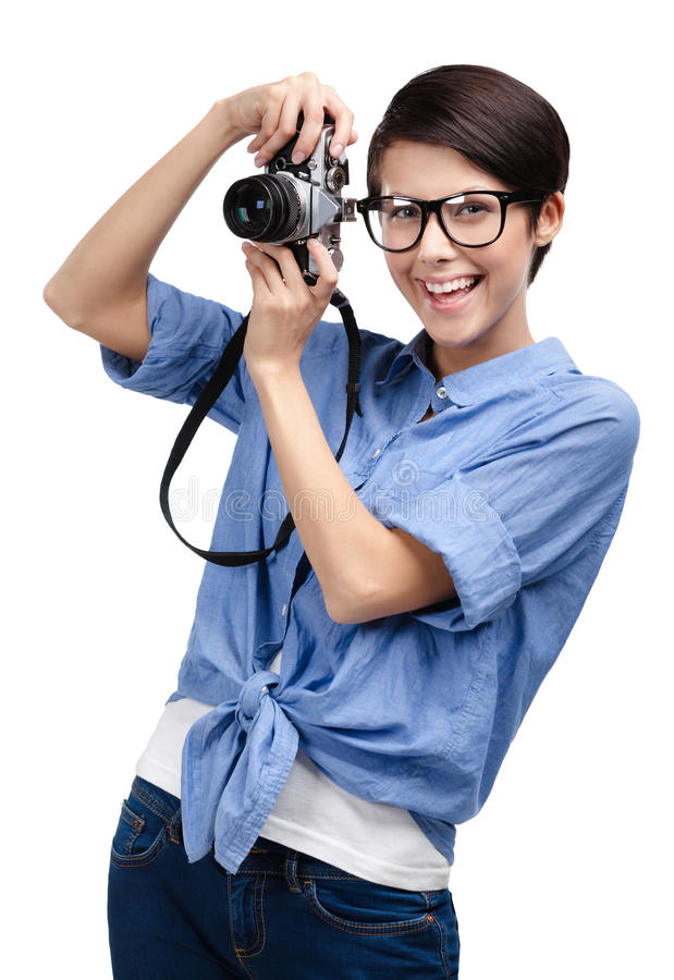 A menina bonita entrega a câmera fotográfica retro fotos de stock royalty free