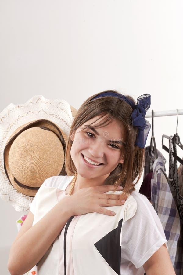 a menina bonita escolhe o vestido imagens de stock royalty free