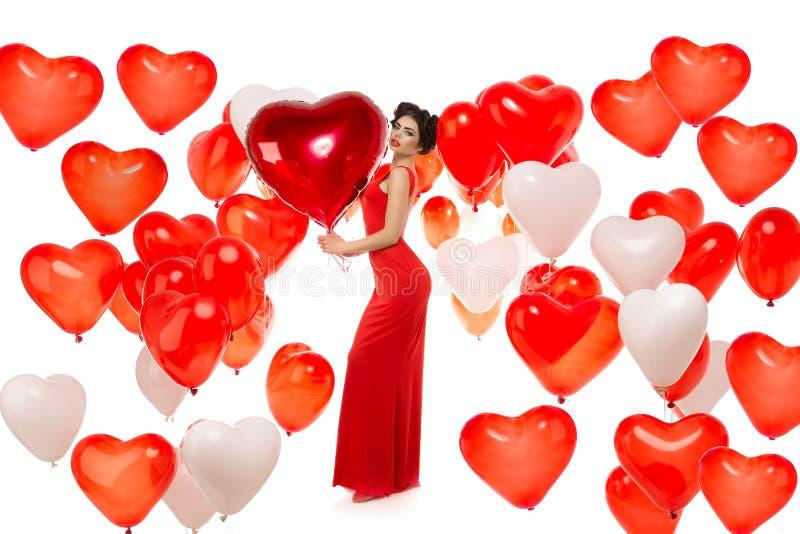 Menina bonita, modelo de forma à moda com os balões na forma foto de stock