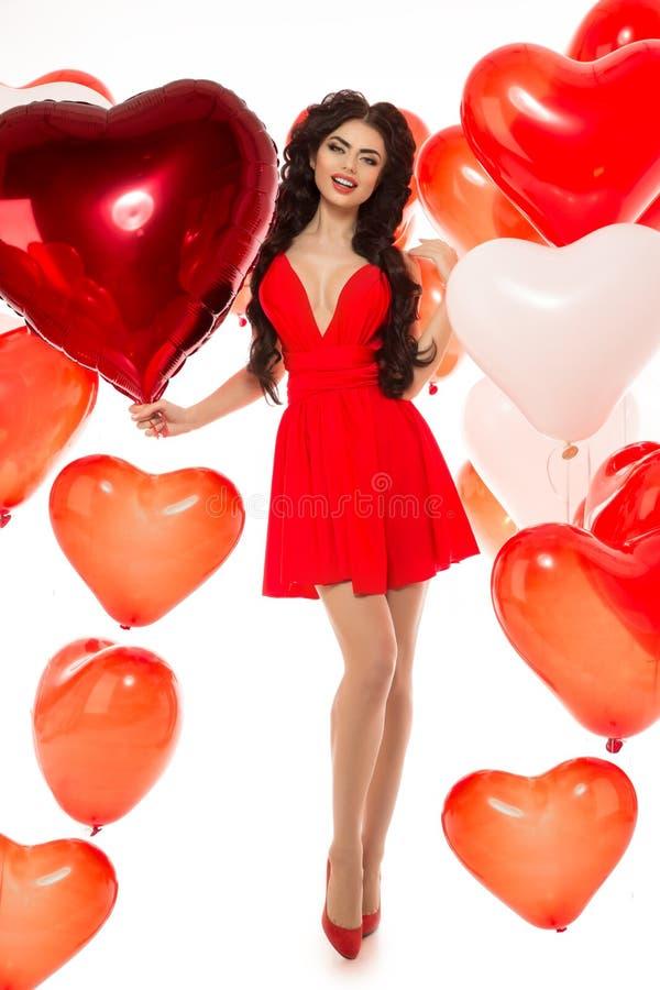 Menina bonita, modelo de forma à moda com os balões na forma fotografia de stock