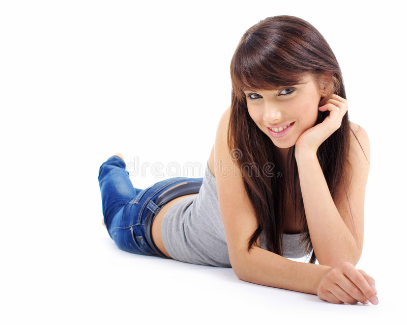 Menina bonita na calças de ganga fotografia de stock