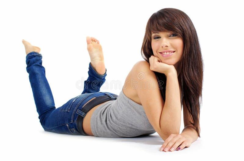 Menina bonita na calças de ganga foto de stock royalty free