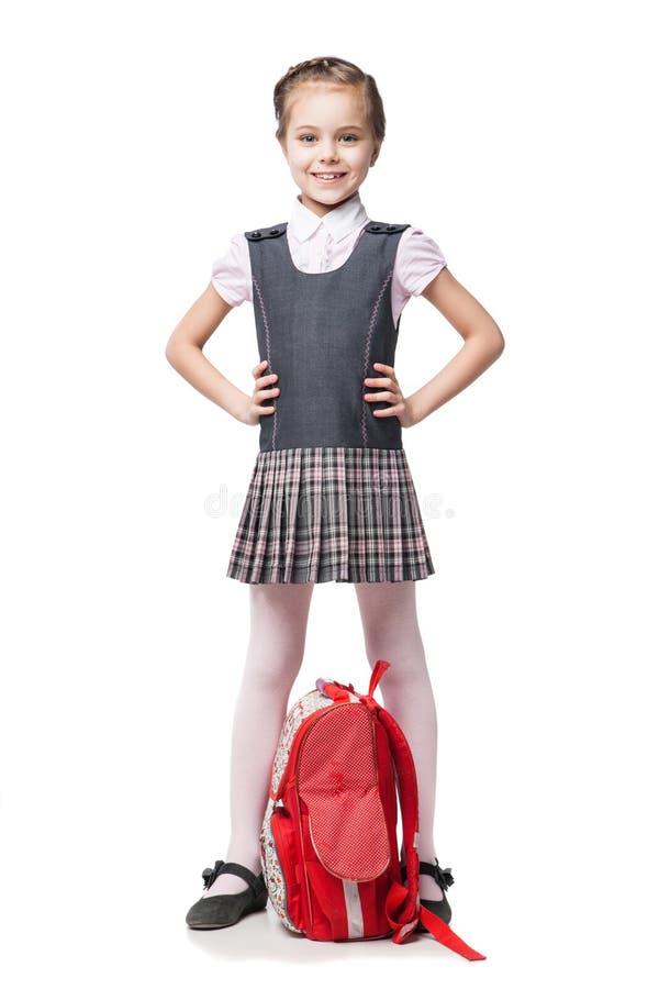 Menina bonita na farda da escola isolada fotos de stock