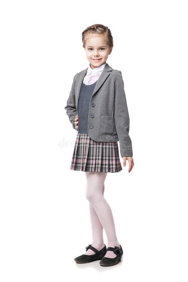 Menina bonita na farda da escola isolada foto de stock royalty free