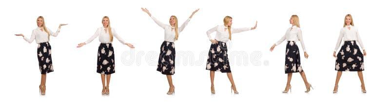 A menina bonita na saia preta com as flores isoladas no branco fotos de stock