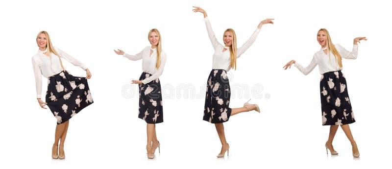 A menina bonita na saia preta com as flores isoladas no branco foto de stock royalty free