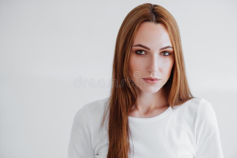 Menina bonita no branco foto de stock royalty free