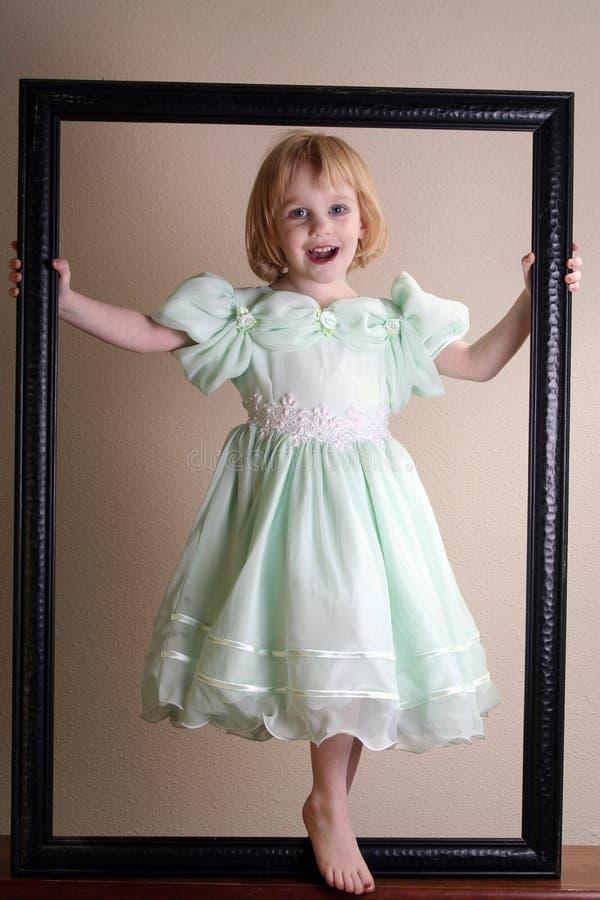 Menina bonita no frame de retrato imagem de stock