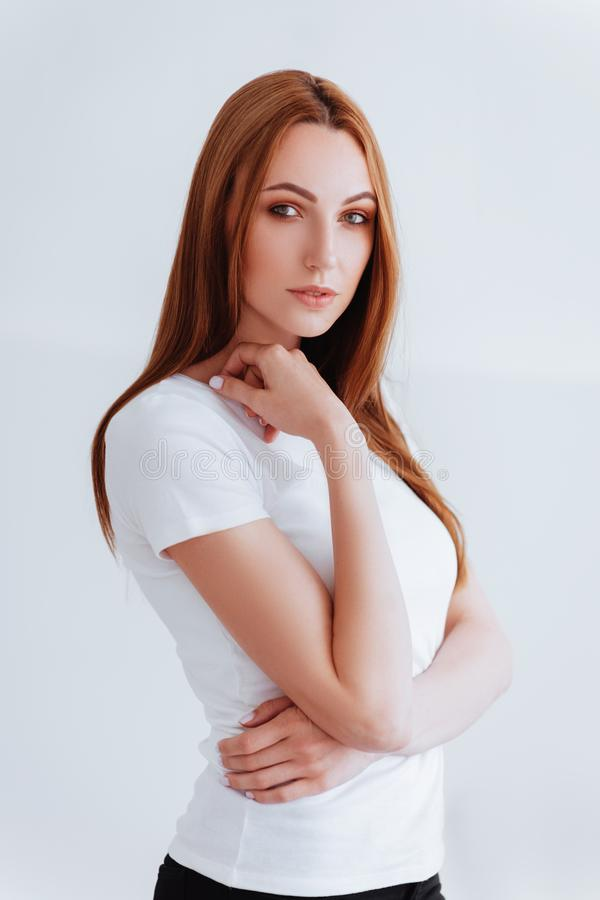 Menina bonita no fundo branco fotos de stock royalty free