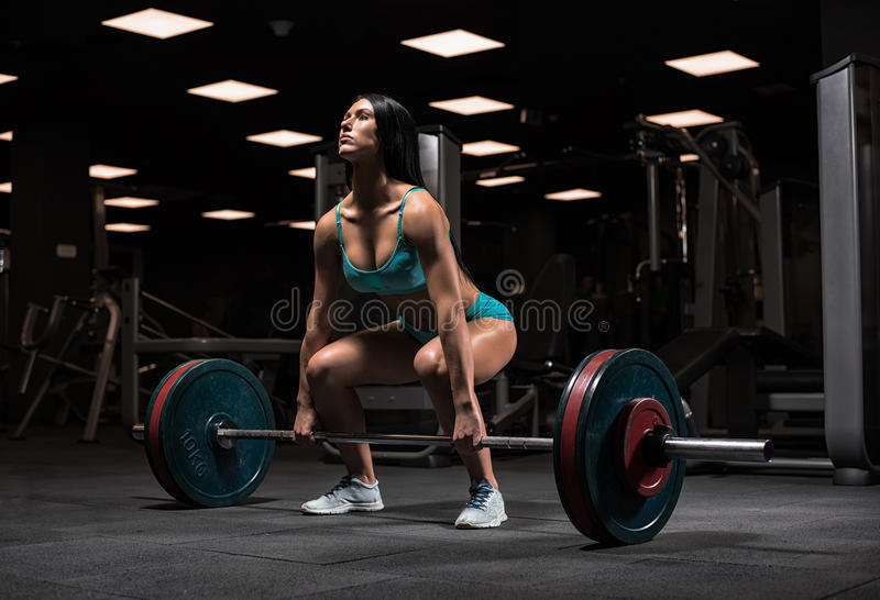 Menina bonita no gym fotografia de stock