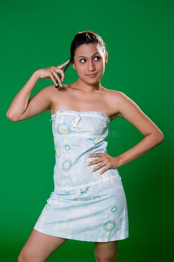 Menina bonita no telefone imagem de stock royalty free