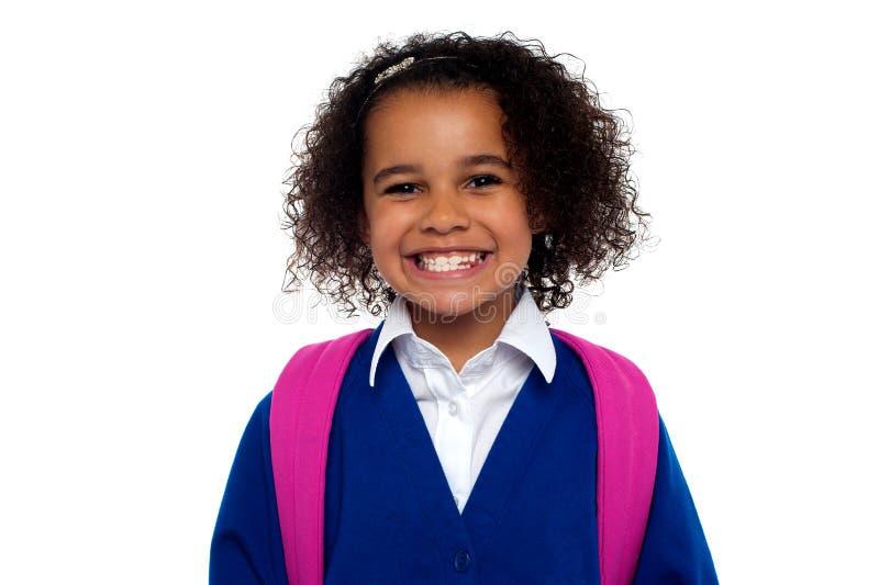 Menina bonita no uniforme foto de stock