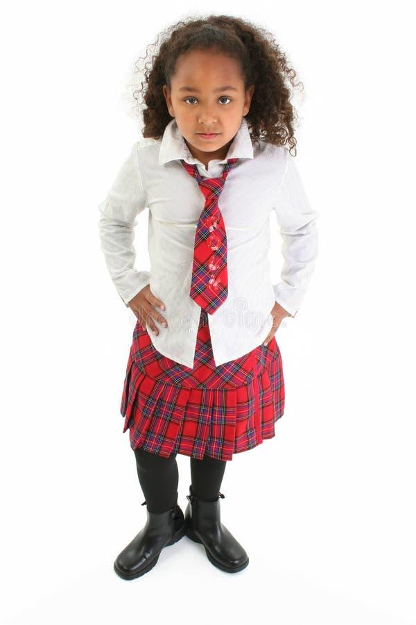 Menina bonita no uniforme da manta fotografia de stock