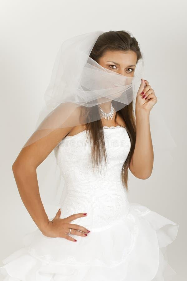 Menina bonita no vestido de casamento imagens de stock royalty free