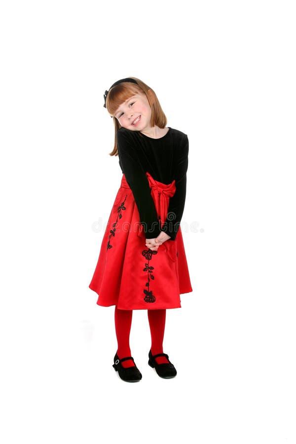 Menina bonita no vestido e em calças justas vermelhos fotos de stock royalty free