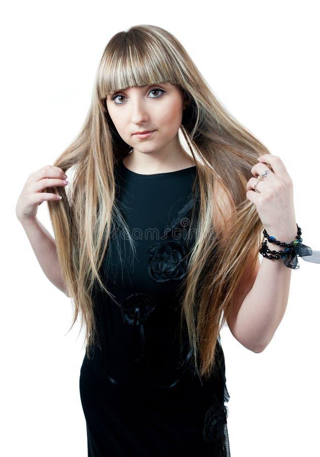 A menina bonita no vestido preto imagem de stock