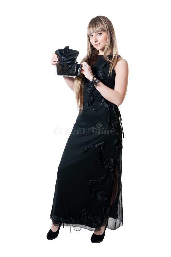 A menina bonita no vestido preto fotos de stock