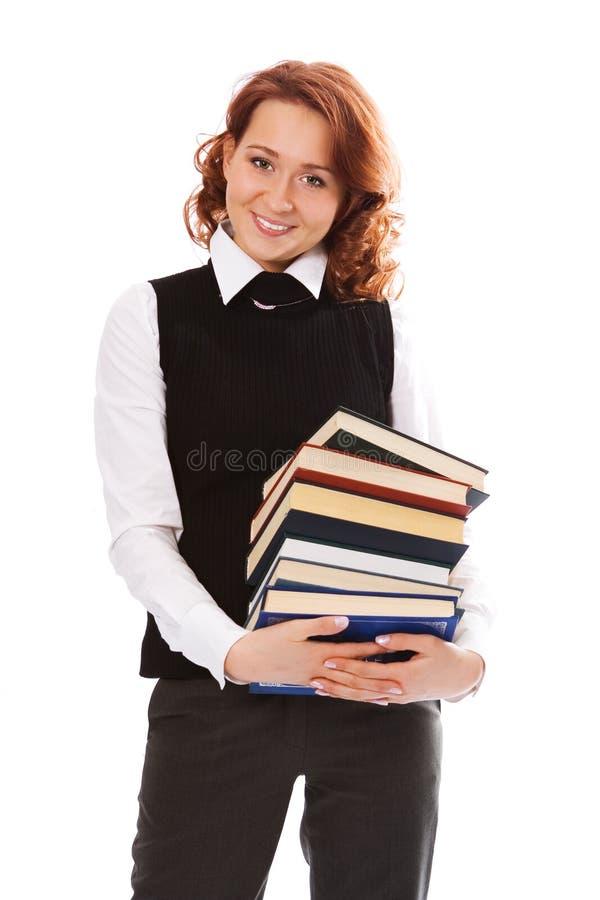 Menina bonita nova do estudante com livros à disposicão imagens de stock