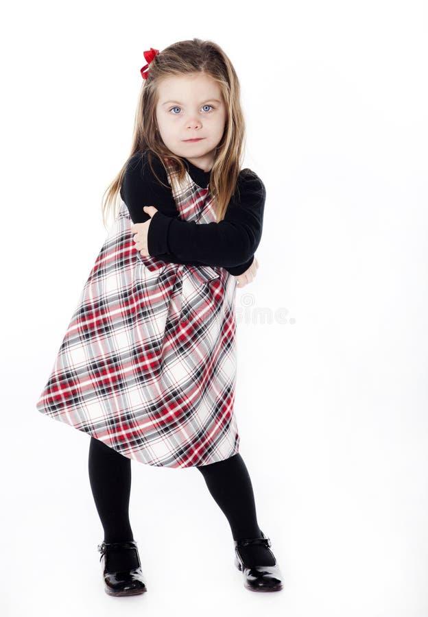 Menina bonita nova em um vestido no branco fotos de stock royalty free