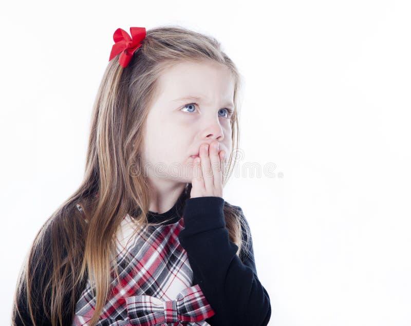 Menina bonita nova em um vestido no fundo branco fotografia de stock royalty free