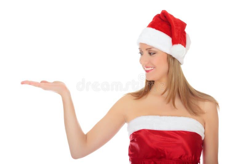 Menina bonita que desgasta o chapéu vermelho do Natal imagens de stock royalty free