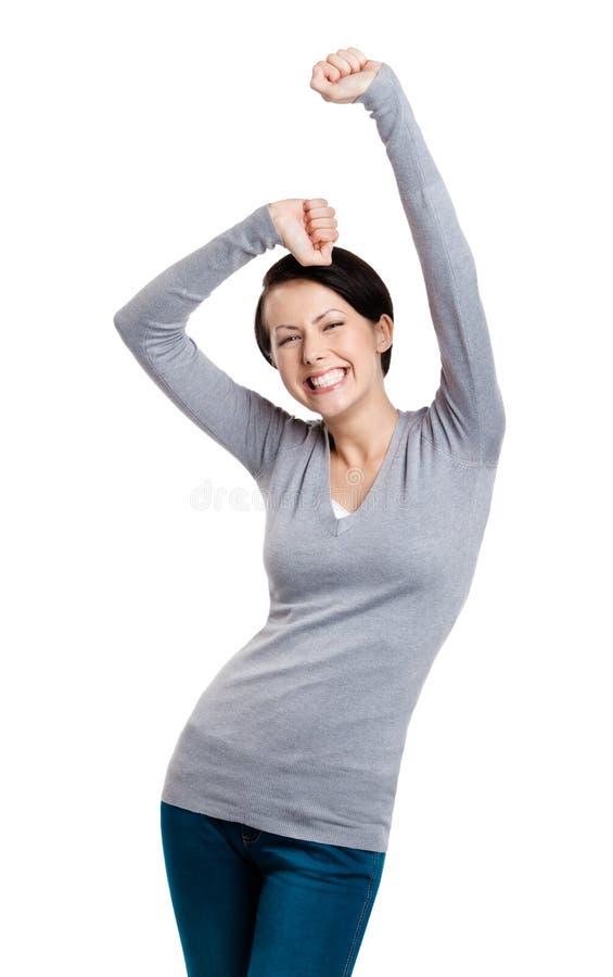 A menina bonita que gesticula os punhos triunfais está feliz fotografia de stock
