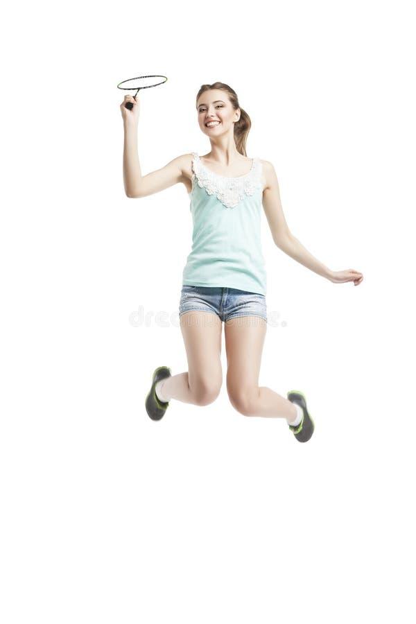 Menina bonita que joga com raquete de badminton imagens de stock