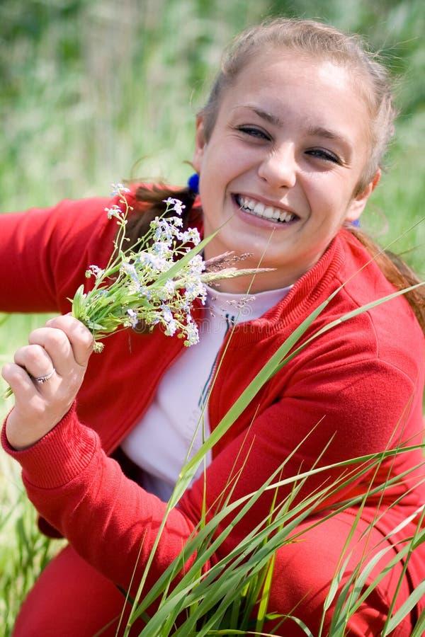 Menina bonita que recolhe flores. #1 fotografia de stock royalty free