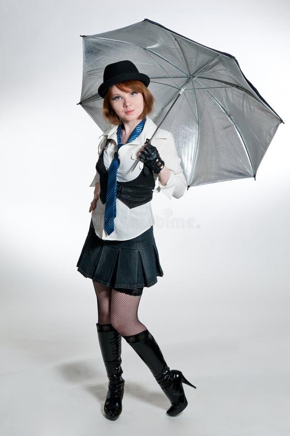 A menina bonita vestida como o gângster fotografia de stock royalty free