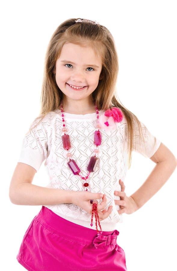 Menina bonito adorável na saia com grânulos fotografia de stock royalty free