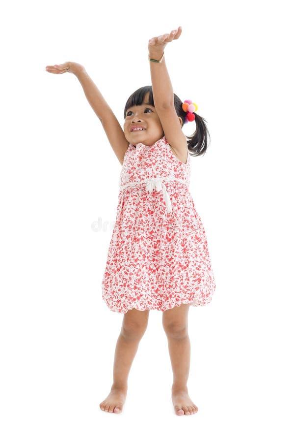 Menina bonito com braços acima fotografia de stock royalty free
