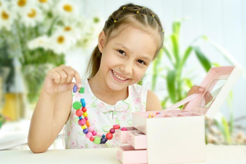 Menina bonito com grânulos imagem de stock royalty free