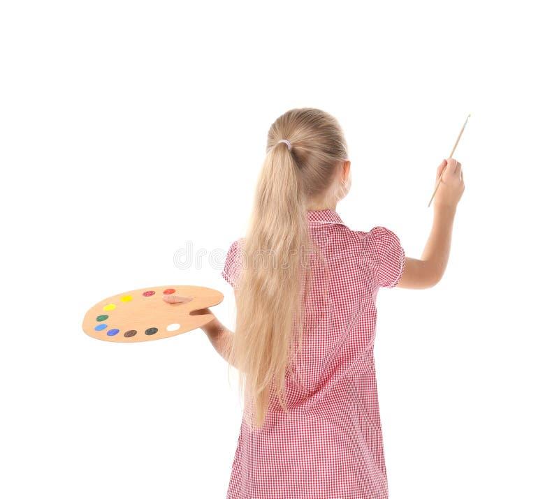 Menina bonito com paleta e escova para pintar, fotografia de stock