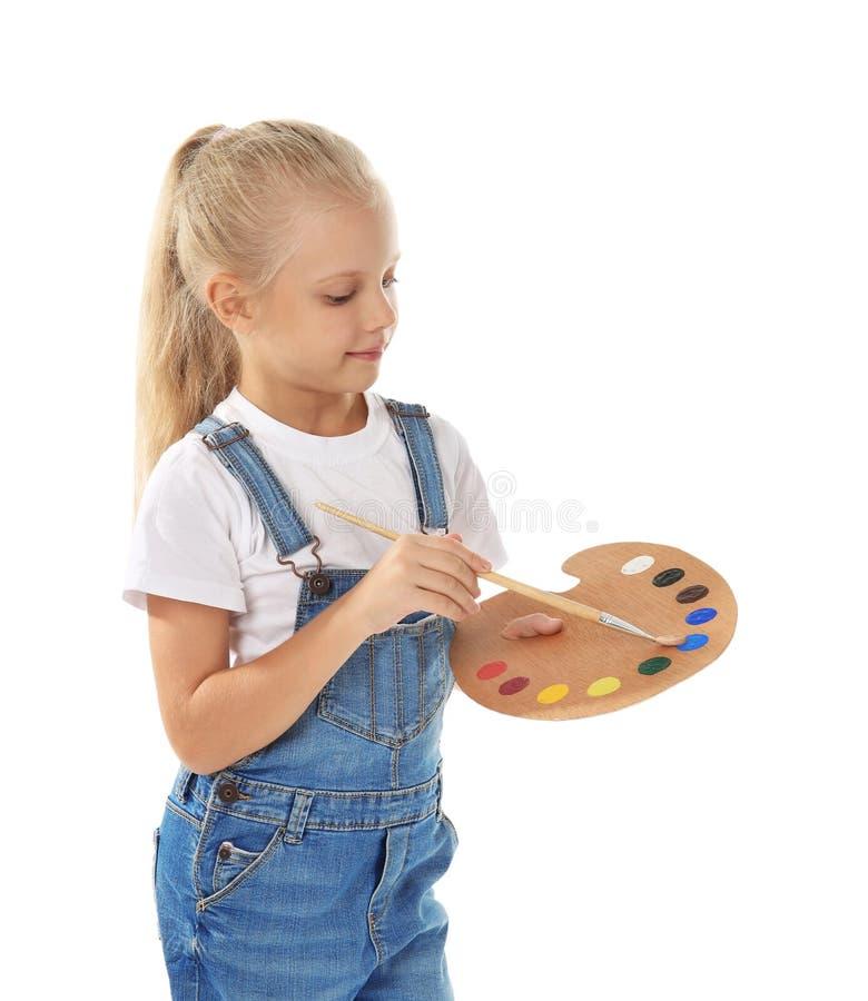 Menina bonito com paleta e escova para pintar fotos de stock