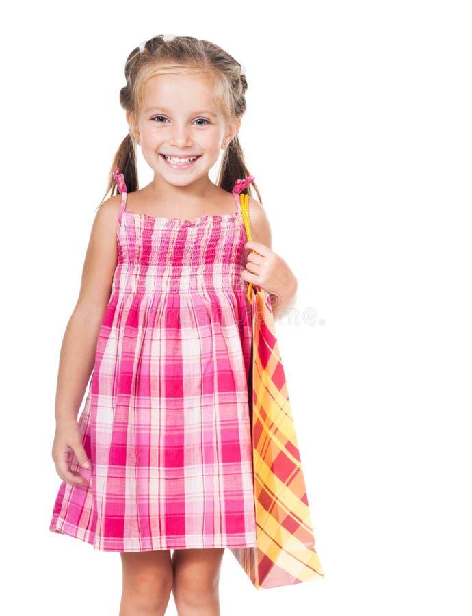Menina bonito com saco de compras foto de stock