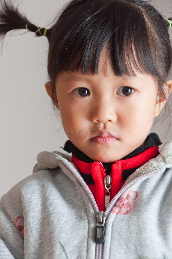 Menina bonito com tranças fotografia de stock royalty free