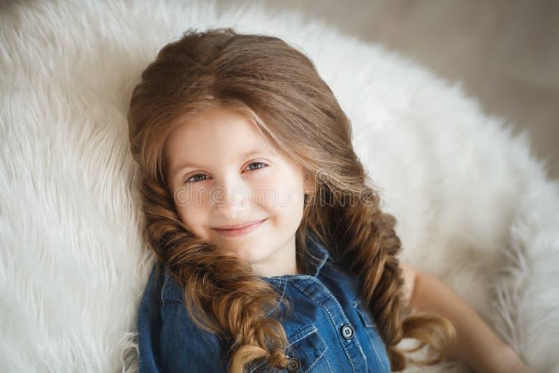 Menina bonito com tranças imagens de stock royalty free