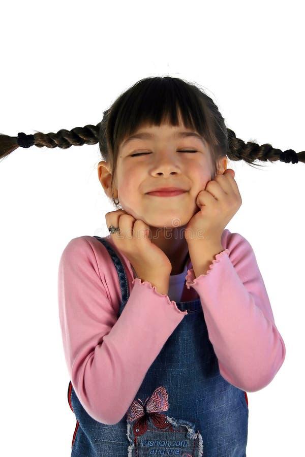 Menina bonito com tranças do cabelo fotografia de stock royalty free