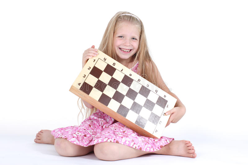 Menina bonito com xadrez no branco imagens de stock