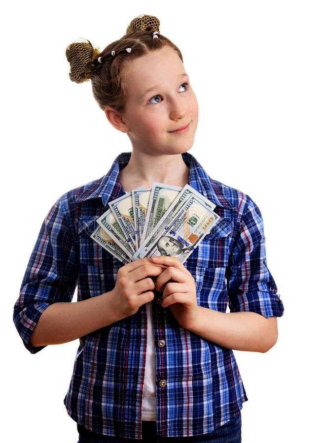 Menina bonito da criança na camisa chekered que guarda os dólares americanos foto de stock