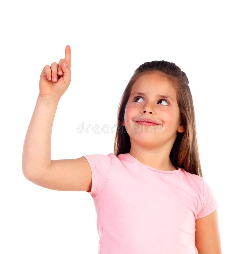Menina bonito da criança que aponta com seu dedo imagem de stock