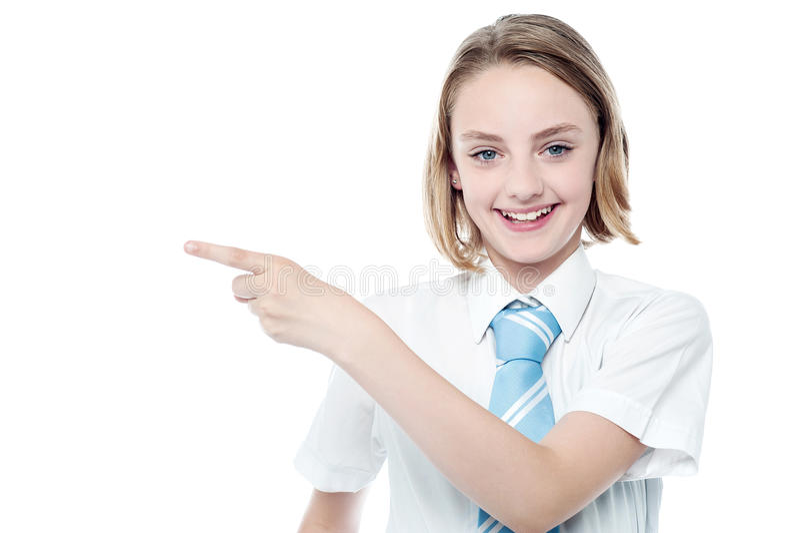 Menina bonito do negócio que aponta afastado imagem de stock