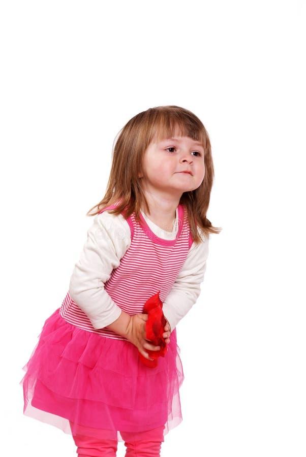 Menina bonito em um vestido cor-de-rosa fotos de stock royalty free