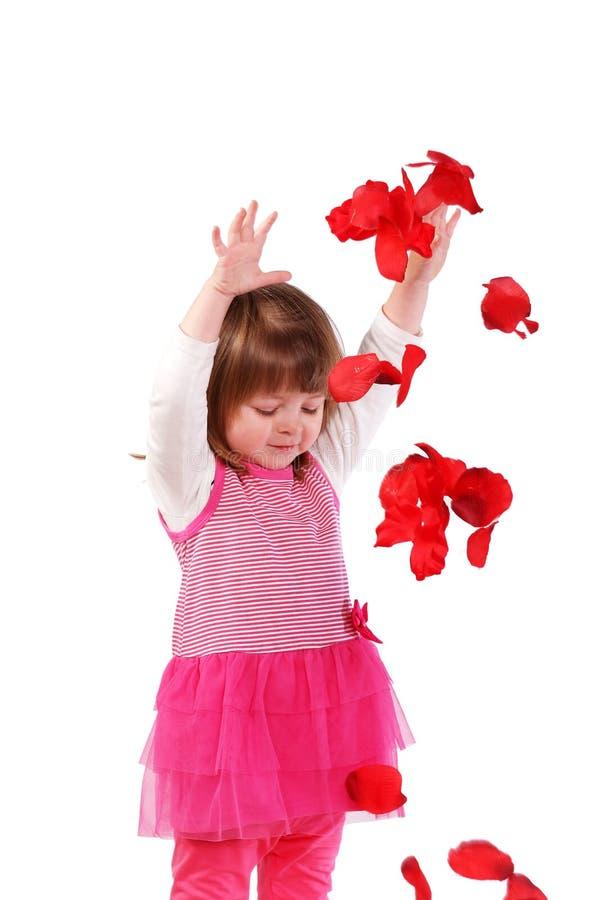 Menina bonito em um vestido cor-de-rosa imagens de stock royalty free