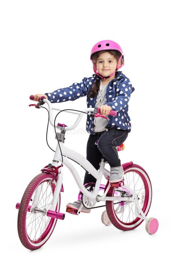 Menina bonito em uma bicicleta fotografia de stock