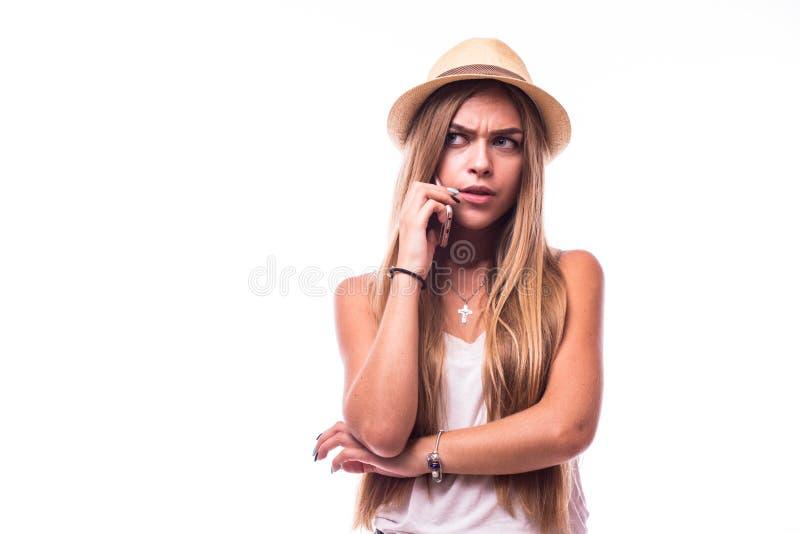 Menina bonito fala desagradada no telefone foto de stock royalty free