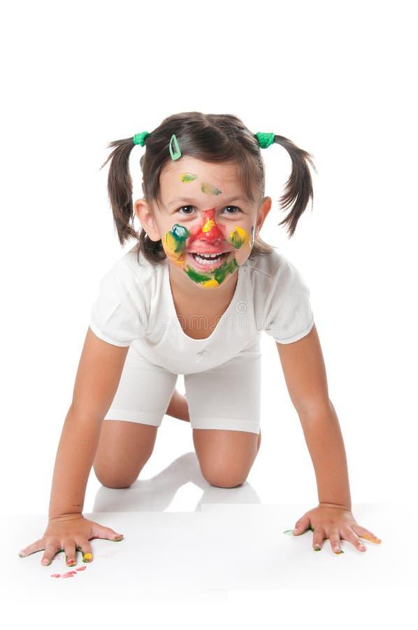 Menina bonito feliz com face pintada foto de stock royalty free